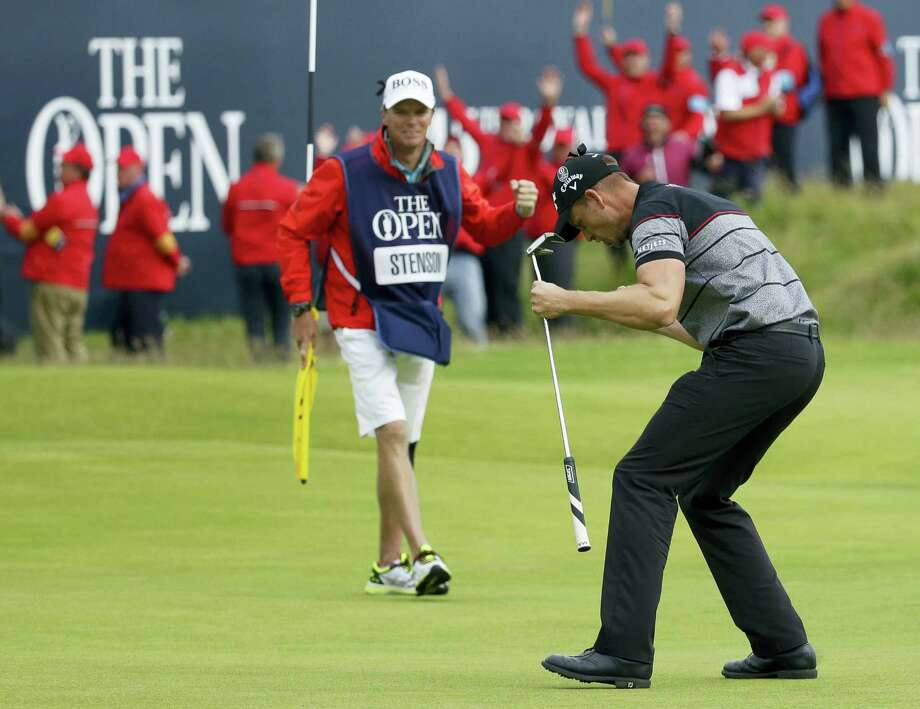 Henrik Stenson of Sweden celebrates as he wins the British Open Golf Championships, after putting out on the 18th green at the Royal Troon Golf Club, in Troon, Scotland on July 17, 2016. Photo: AP Photo/Matt Dunham  / Copyright 2016 The Associated Press. All rights reserved. This material may not be published, broadcast, rewritten or redistribu
