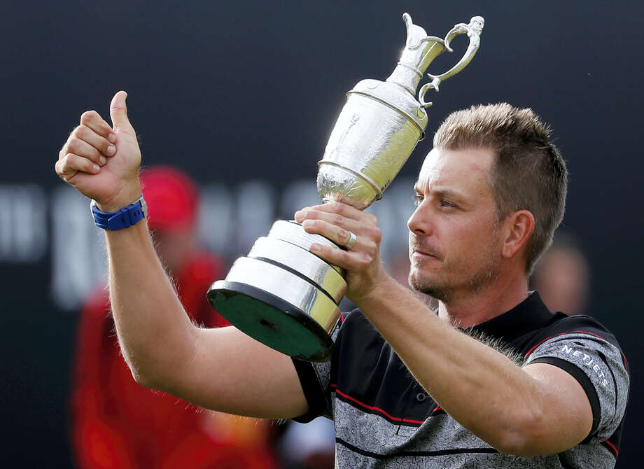 Henrik Stenson holds up the trophy after winning the British Open at the Royal Troon Golf Club in Troon, Scotland on Sunday. Photo: Ben Curtis — The Associated Press  / Copyright 2016 The Associated Press. All rights reserved. This material may not be published, broadcast, rewritten or redistribu