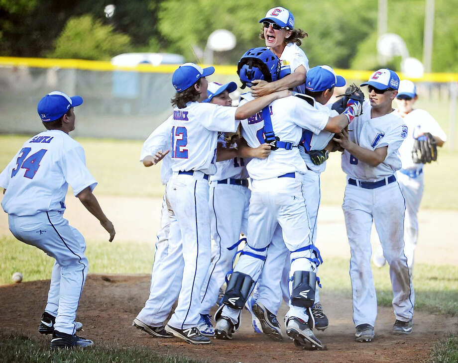 The Coginchaug Little League Intermediate team celebrates after defeating Fairfield American, 9-4, Sunday at Peckham Park in Middlefield. Photo: Jimmy Zanor - The Middletown Press