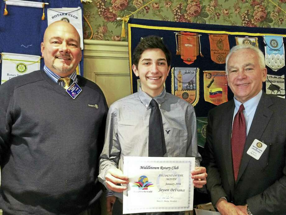 From left are Rotary Club President Bruce Driska, student of the month Jayson DeFrance and student of the month Chair Garry Mullaney. DeFrance, who attends Middletown High School, was honored Jan. 5 at First and Last Tavern. Photo: Courtesy Photo