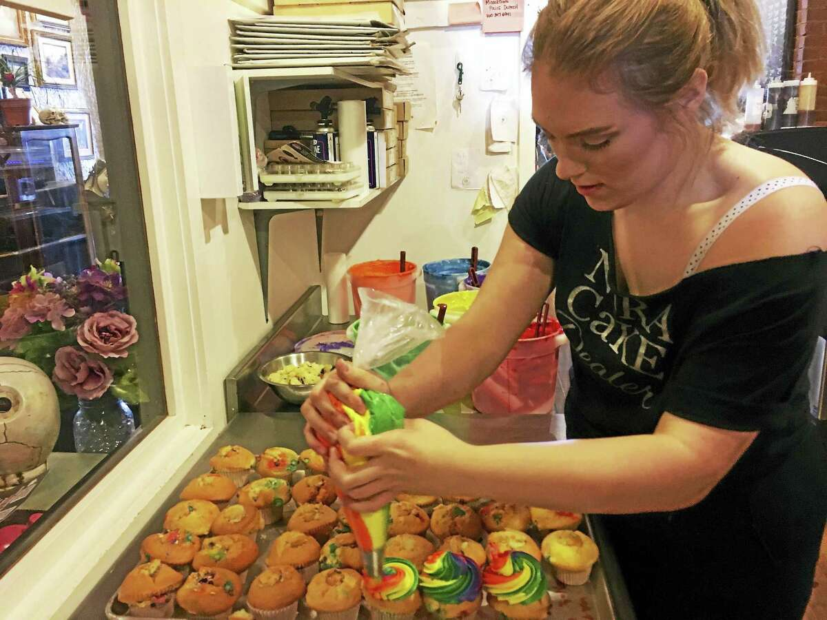 Audrey LaRosa, who has worked at the bakery for the past two years, frosts a cupcake Thursday.