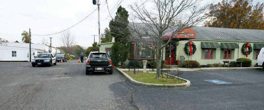 Oceanport police control access on the long driveway that leads to the rear of the Froggia Florist and Greenhouses where the body of Joseph Comunale, a missing Hofstra University graduate originally from Connecticut, was reportedly found Wednesday, Nov. 16, 2016. Photo: Thomas P. Costello — The Asbury Park Press Via AP / Gannett NJ / USA Today Network