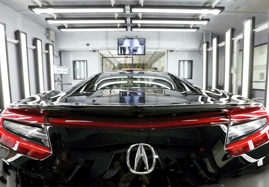 In this March 9, 2016 photo, the NSX, Acura's next-generation supercar, sits in the final inspection room in Acura's new Performance Manufacturing Center in Marysville, Ohio. The next generation of Acura's top-of-the-line NSX is ready to begin full production in Ohio in late April. Photo: AP Photo/Jay LaPrete  / FR52593 AP