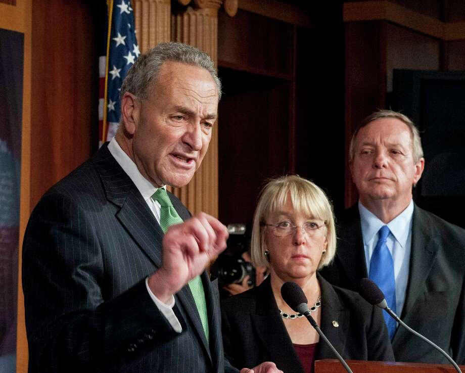 Sen. Chuck Schumer, D-N.Y., left, during a press conference in the United States Capitol in Washington on Oct. 16, 2013. with Sens. Patty Murray, D-Wash., and Dick Durbin, D-Ill. Photo: Bloomberg Photo By Pete Marovich. / (c) 2013 Bloomberg Finance LP