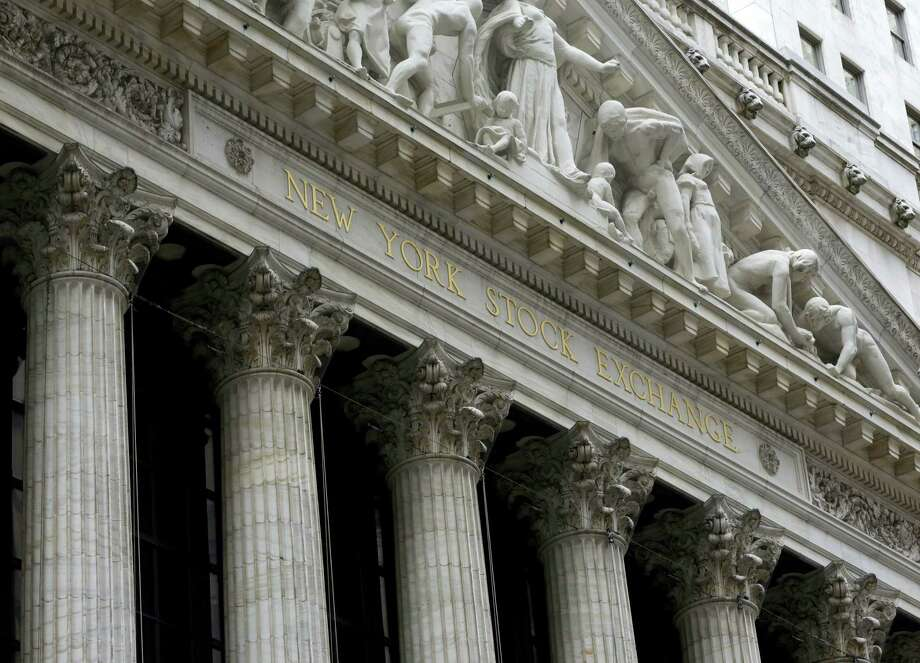 FILE - This Thursday, Oct. 2, 2014, file photo, shows the facade of the New York Stock Exchange. U.S. stocks moved little in early trading Thursday, March 17, 2016, as investors weighed a report on unemployment benefits and corporate news. Photo: THE ASSOCIATED PRESS / AP