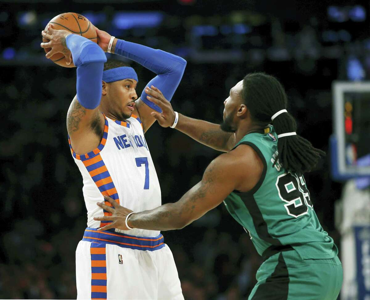New York Knicks forward Carmelo Anthony (7) looks to pass as Boston Celtics forward Jae Crowder (99) defends in the first half.
