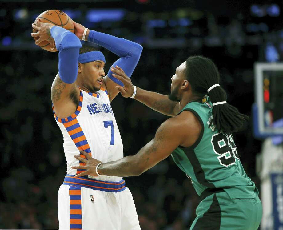 New York Knicks forward Carmelo Anthony (7) looks to pass as Boston Celtics forward Jae Crowder (99) defends in the first half. Photo: Kathy Willens — The Associated Press  / AP