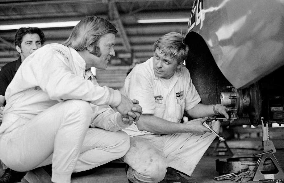 In this 1970 file photo, Fred Lorenzen, left, confers with a member of his pit crew. Lorenzen has pledged his brain to the Concussion Legacy Foundation. He joins Dale Earnhardt Jr. as the only NASCAR drivers to make the pledge. Photo: The Associated Press File Photo  / AP1970