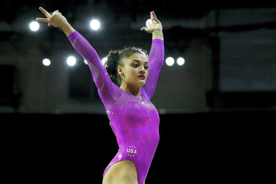 Laurie Hernandez, 16, is the youngest member of the powerhouse U.S. Olympic women's gymnastics team. Photo: The Associated Press File Photo  / The Herald