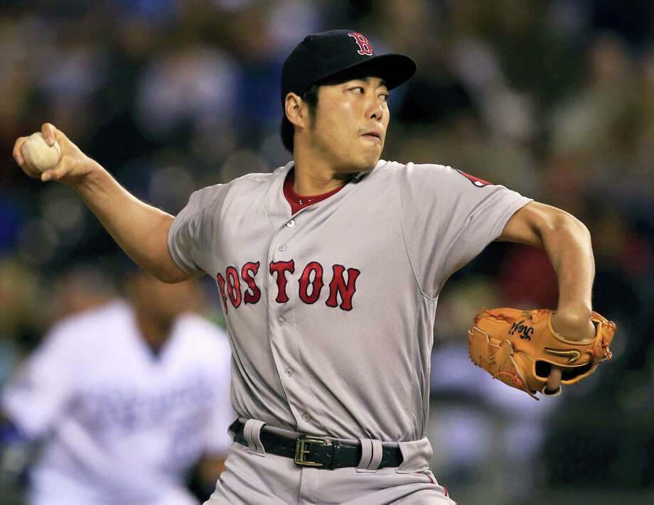 Koji Uehara delivers a pitch in the eighth inning on Tuesday. Photo: Orline Wagner — The Associated Press  / Copyright 2016 The Associated Press. All rights reserved. This material may not be published, broadcast, rewritten or redistribu
