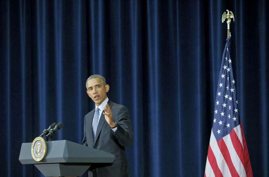 President Barack Obama speaking at the Chief of Missions Conference at the State Department in Washington Monday. Photo: Associated Press  / AP