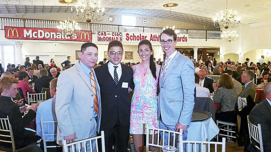 From left are: Middletown High wrestling coach Mark Fong, CIAC Scholar-Athletes Andre Rogers and Alexandra DeFrance and Ultimate Frisbee coach Trevor Charles at the CIAC Scholar Athlete Awards dinner at the Aqua Turf Club in Southington. Photo: Contributed Photo