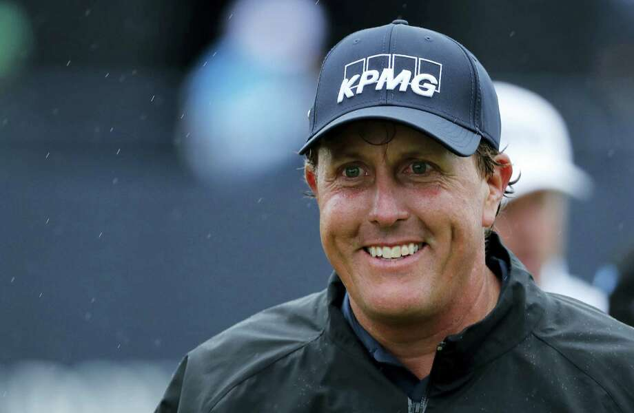 Phil Mickelson will enter the final round of the British Open on Sunday one shot behind leader Henrik Stenson. Photo: Ben Curtis — The Associated Press  / Copyright 2016 The Associated Press. All rights reserved. This material may not be published, broadcast, rewritten or redistribu
