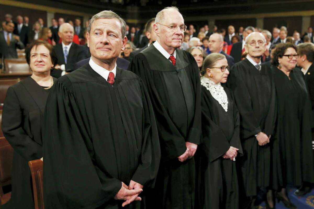 Supreme Court Justice Elena Kagan, from left, Chief Justice John Roberts, Justice Anthony Kennedy, Justice Ruth Bader Ginsburg, Justice Stephen Breyer, and Justice Sonia Sotomayor arrive before President Barack Obama delivers the State of the Union address to a joint session of Congress on Capitol Hill in Washington on Tuesday.