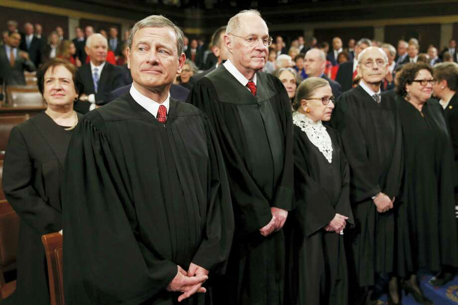 Supreme Court Justice Elena Kagan, from left, Chief Justice John Roberts, Justice Anthony Kennedy, Justice Ruth Bader Ginsburg, Justice Stephen Breyer, and Justice Sonia Sotomayor arrive before President Barack Obama delivers the State of the Union address to a joint session of Congress on Capitol Hill in Washington on Tuesday. Photo: The Associated Press  / AP Pool
