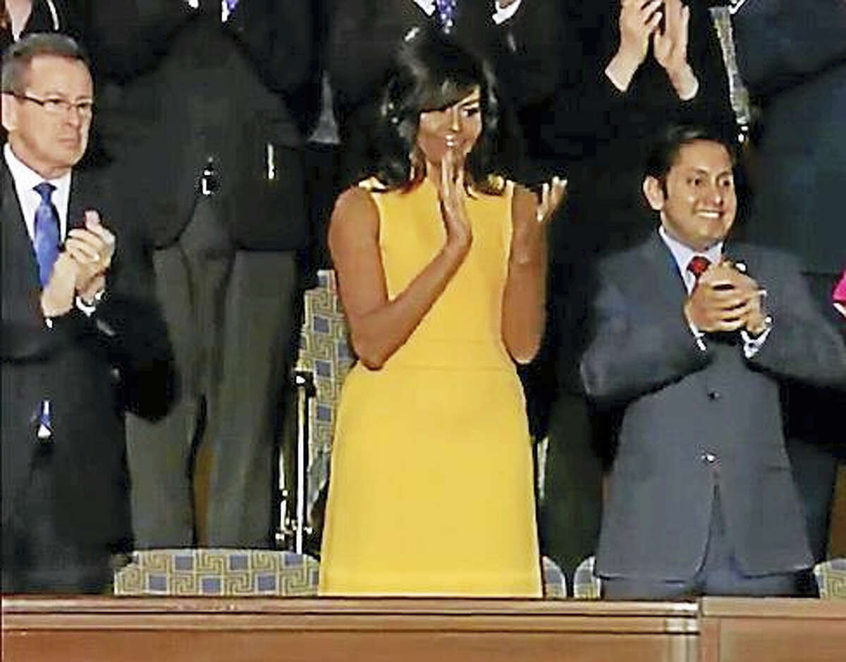 Gov. Dannel P. Malloy was seated one empty seat away from First Lady Michelle Obama on Tuesday for the president's last State of the Union address. The seat was left empty in honor of the victims of gun violence in America.