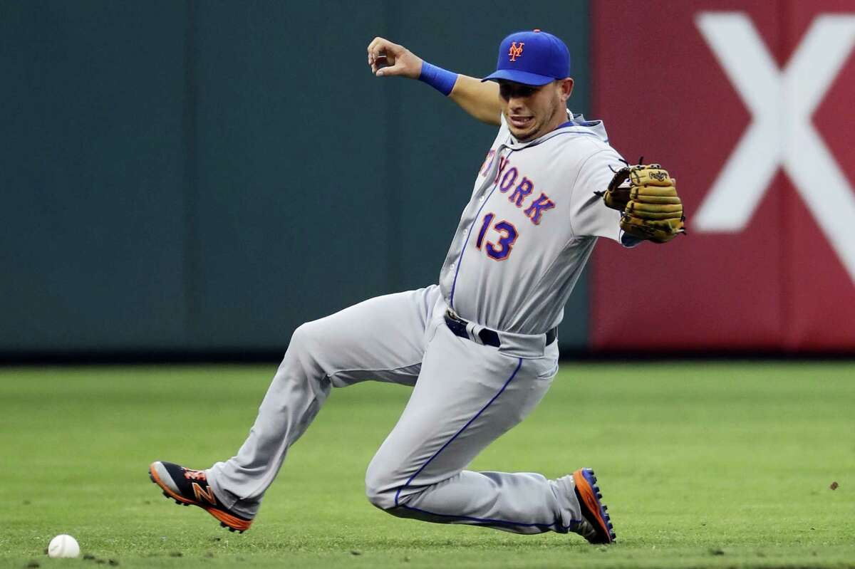 Mets shortstop Asdrubal Cabrera chases down a single by the Phillies' Cody Asche during the first inning Saturday.