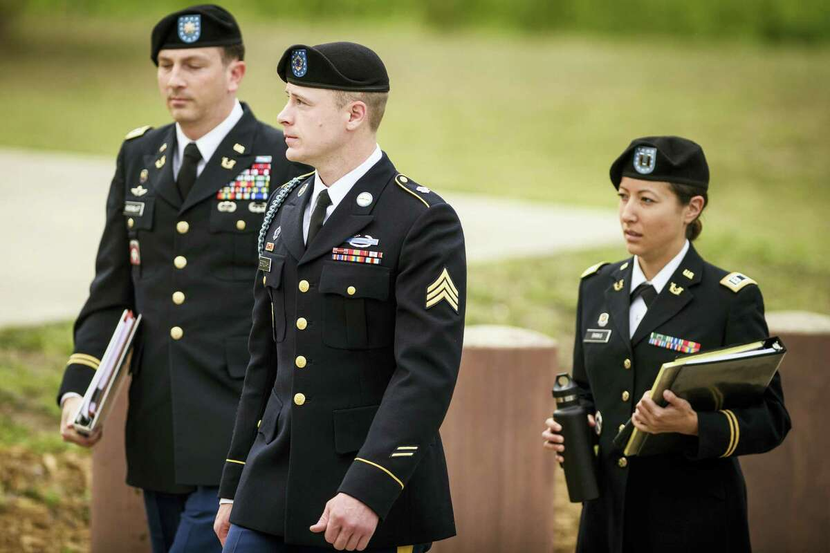 Army Sgt. Bowe Bergdahl, center, arrives at the Fort Bragg courtroom facility for an arraignment hearing on May 17, 2016 on Fort Bragg, N.C. The hearing could result in his court-martial being moved until after this fall's elections.