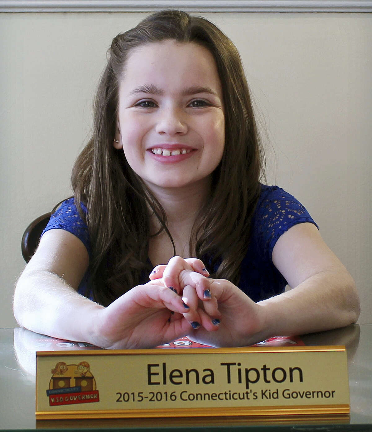 In this Jan, 29 photo, Elena Tipton of East Hartford poses in the former governor's office at Connecticut's Old State House in Hartford. Elena, 11, was elected as Connecticut's kid governor in 2015.