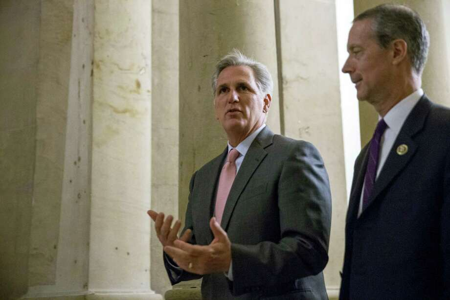 House Majority Leader Kevin McCarthy of California, center, is accompanied by House Armed Services Committee Chairman Rep. Mac Thornberry, R-Texas, right. Photo: File Photo  / AP