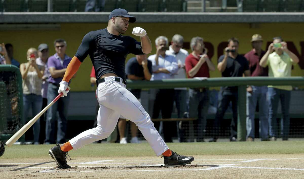In this Aug. 30, 2016 photo, former NFL quarterback Tim Tebow hits during batting practice for baseball scouts and the media during a showcase on the campus of the University of Southern California, in Los Angeles.