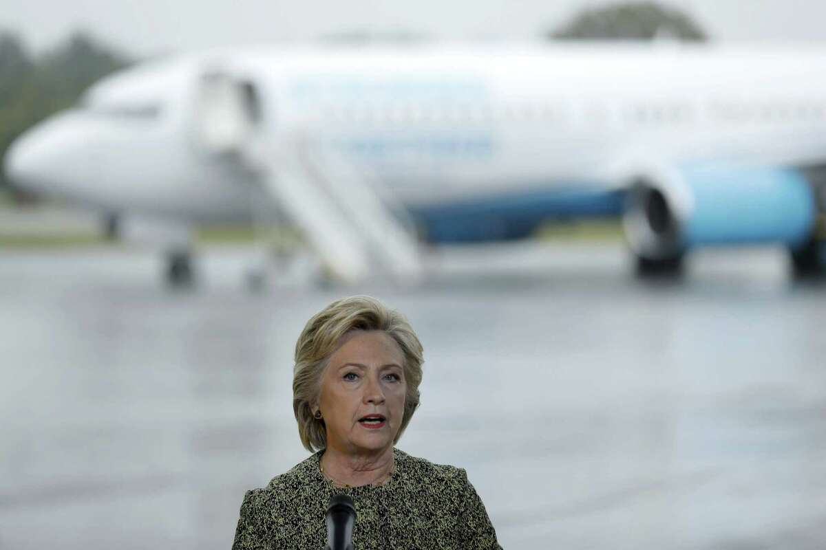 Democratic presidential candidate Hillary Clinton speaks with members of the media at Westchester County Airport in White Plains, N.Y. on Sept. 19, 2016.