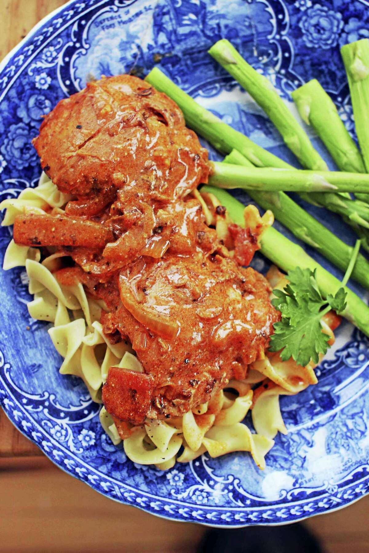 This easy weeknight chicken dish sports a sauce rich with tomatoes and paprika. Stirring sour cream into it just before serving transforms it into a true comfort food.