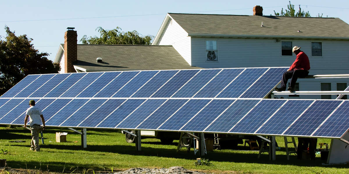 The 8,000-watt solar panels on this home provide all the power needed by a family of five.