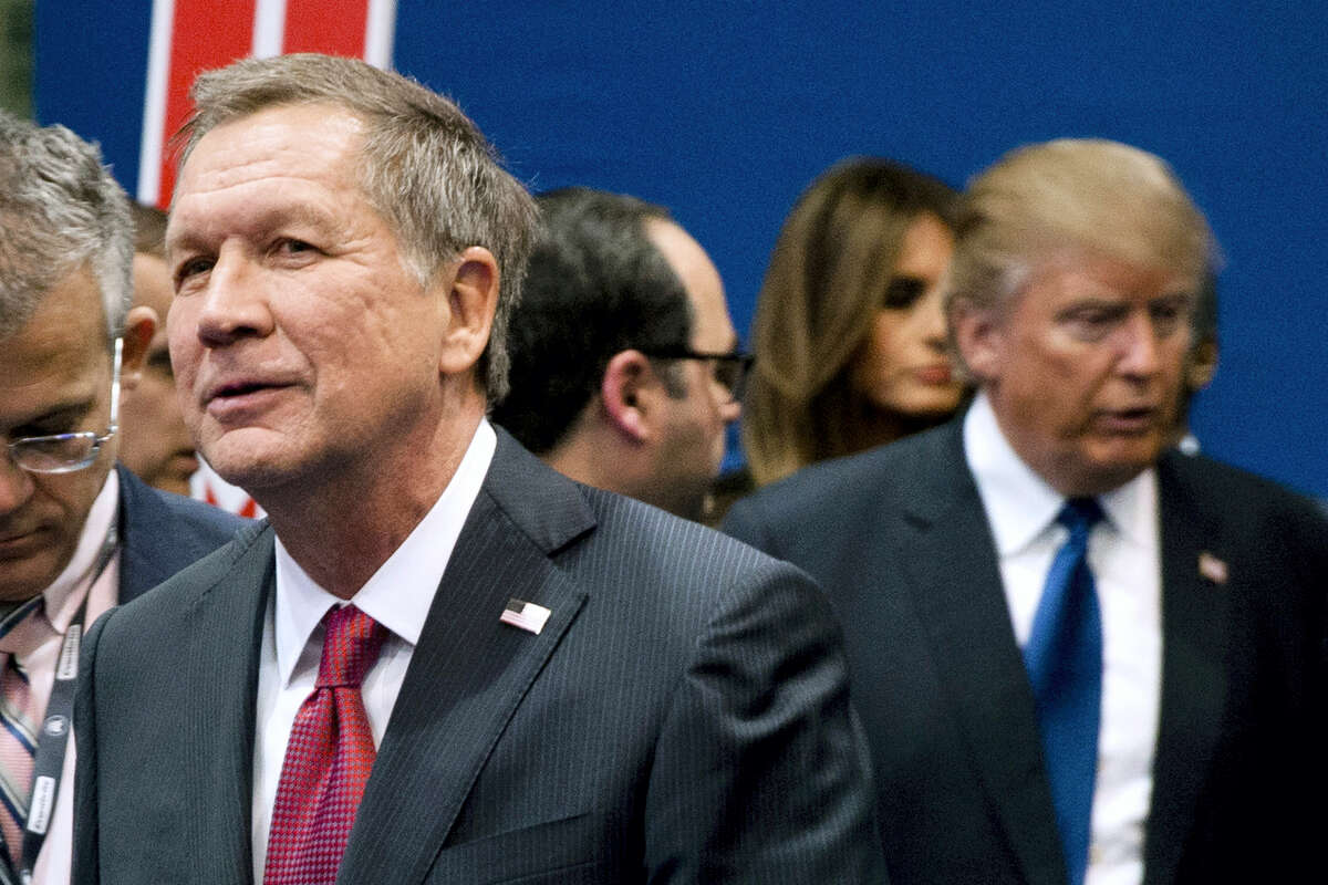 In this Feb. 6, 2016, file photo, Ohio Gov. John Kasich, left, and Donald Trump, right, speak to reporters after a Republican presidential primary debate hosted by ABC News at Saint Anselm College in Manchester, N.H. While Trump is bypassing the NAACP national convention taking place in Cincinnati from Saturday to Wednesday, July 16 to 20, a Kasich spokeswoman confirmed Friday, July 15, 2016, that the governor will speak to the NAACP on Sunday, July 17 a day before Hillary Clinton's speech to the NAACP and the start of the Republican National Convention in Cleveland.