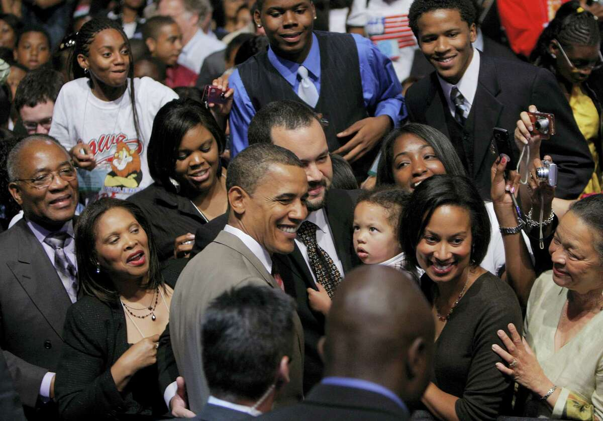 In this July 14, 2008, file photo, Democratic presidential candidate and U.S. Sen. Barack Obama, D-Ill., meets audience members attending his speech at the NAACP's national convention in Cincinnati. Presumptive Democratic presidential nominee Hillary Clinton is scheduled to speak during the NAACP's national convention in Cincinnati on Monday, July 18, 2016, the same day the Republican National Convention begins in Cleveland.