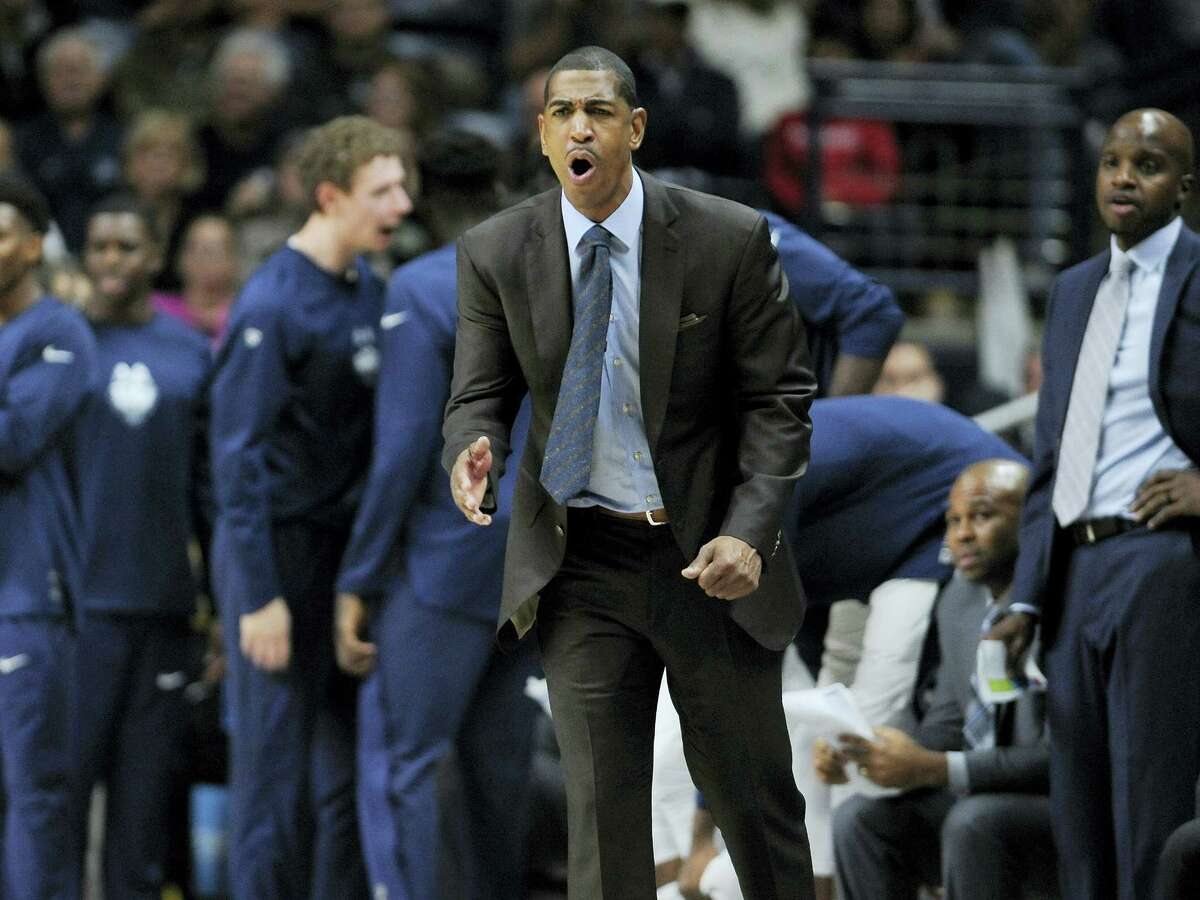 Connecticut head coach Kevin Ollie reacts in the second half of an NCAA college basketball game against Northeastern, Monday, Nov. 14, 2016, in Storrs, Conn. (AP Photo/Jessica Hill)