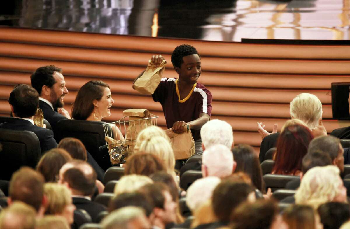 Caleb McLaughlin distributes sandwiches at the 68th Primetime Emmy Awards on Sunday, Sept. 18, 2016 at the Microsoft Theater in Los Angeles.