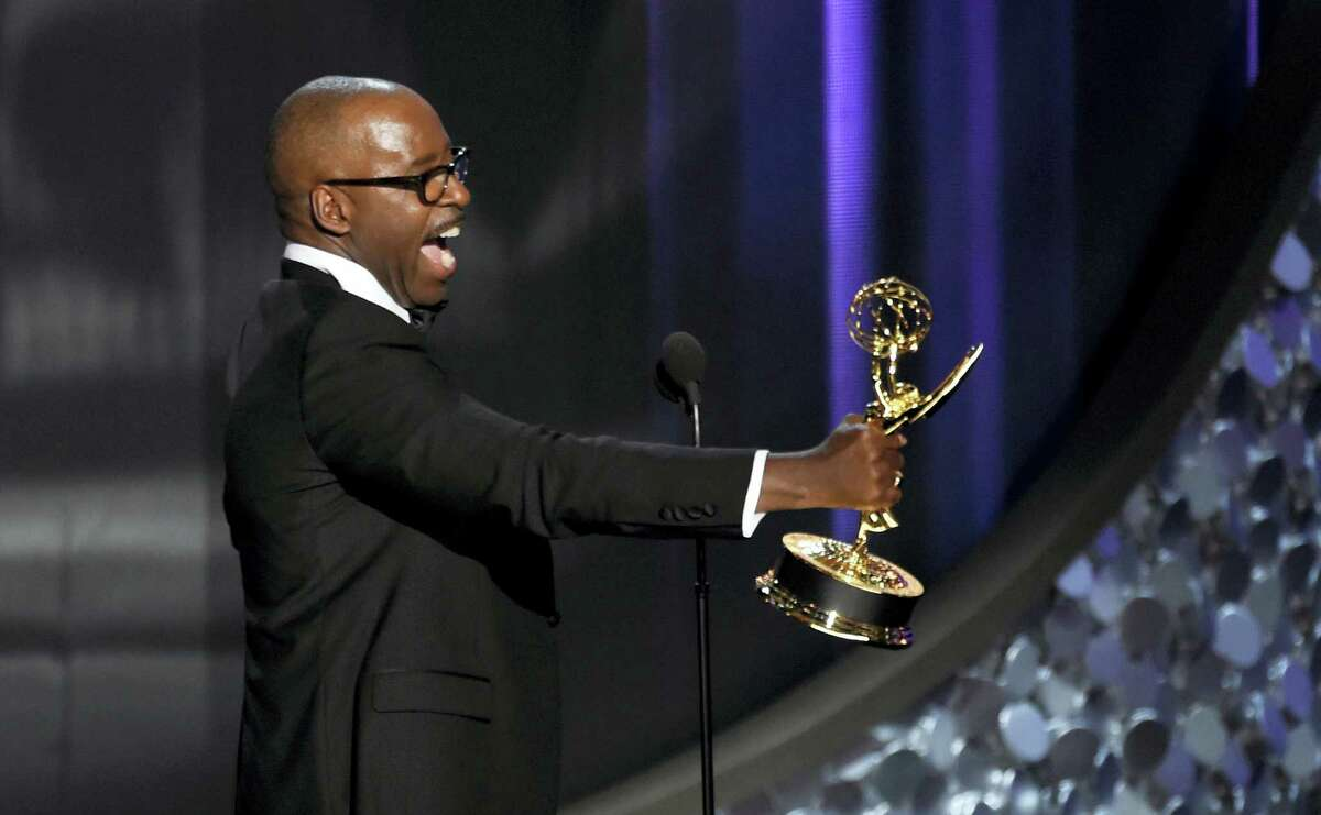 """Courtney B. Vance accepts the award for outstanding lead actor in a limited series or a movie for """"The People v. O.J. Simpson: American Crime Story"""" at the 68th Primetime Emmy Awards on Sunday, Sept. 18, 2016 at the Microsoft Theater in Los Angeles."""