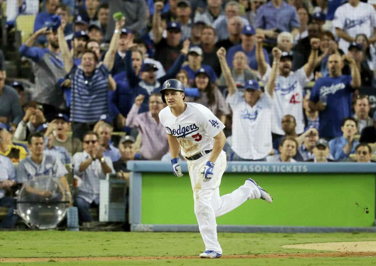 THE ASSOCIATED PRESS FILE PHOTO Los Angeles Dodgers' Corey Seager hits an RBI single during the third inning of Game 3 of the National League baseball championship series against the Chicago Cubs in Los Angeles. Seager and the Detroit Tigers' Michael Fulmer were named the MLB Rookies of the Year on Monday.