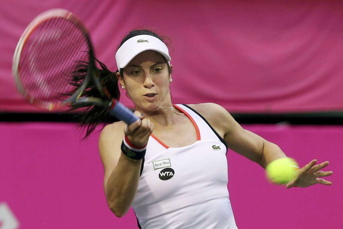 Christina Mchale of the United States returns a shot to Victoria Golubic of Switzerland during their quarter-final match of the Japan Women's Open tennis tournament in Tokyo on Sept. 16, 2016.