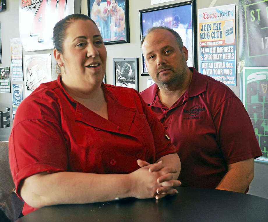 Business owners Carmela and Matt Lockwood are known for their support of local causes and the work of civil servants. They own Matty's Next Door and Jerry's Pizza on South Main Street as well as the newly opened Carmela's on the Extension in Middletown. Photo: Cassandra Day — The Middletown Press