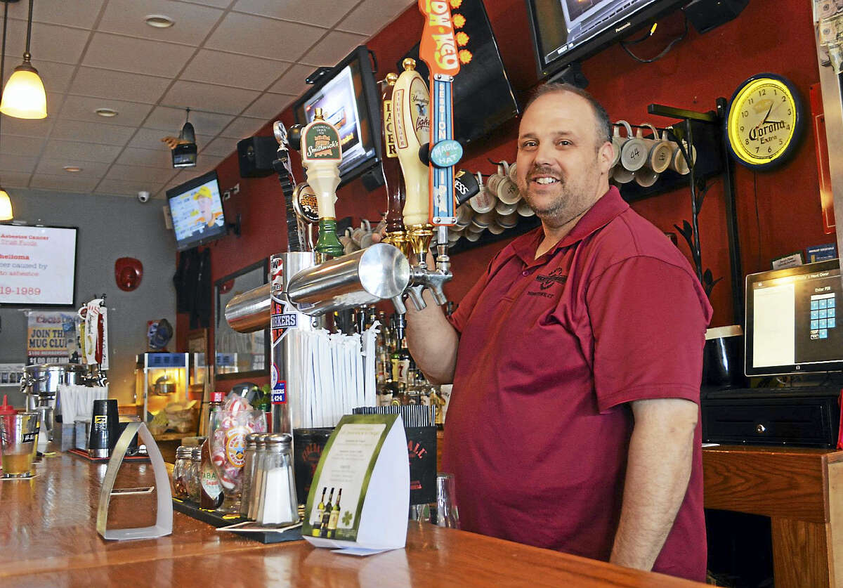 The Elks Irish Person of the Year Matt Lockwood serves up a Guinness stout for a customer at Matty's Next Door Sports Bar in Middletown on Wednesday.
