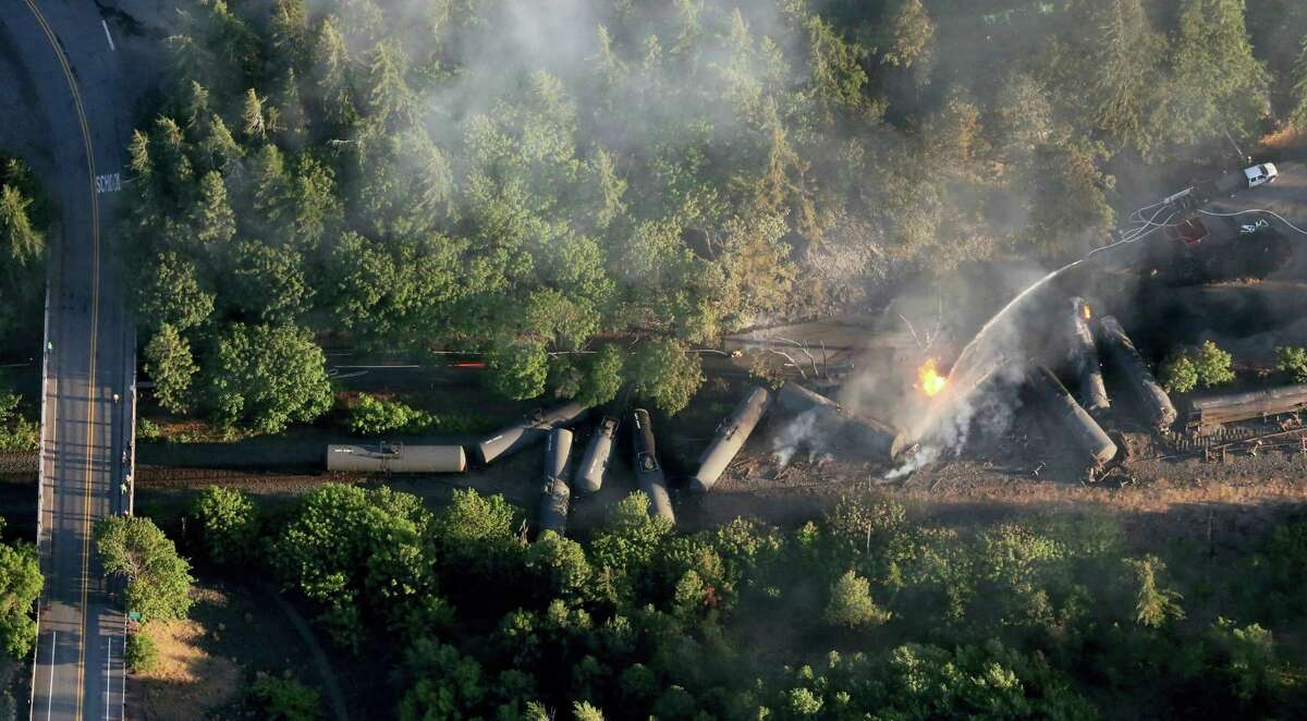 In this June 3 photo, an oil train burns near the town of Mosier, Ore., after derailing. U.S. safety officials say they've seen slow progress in efforts to upgrade or replace tens of thousands of rupture-prone rail cars used to transport oil and ethanol, despite a string of fiery derailments.