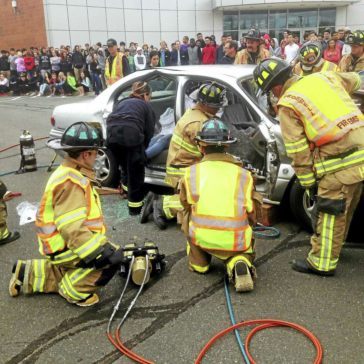 On Monday, first responders simulated the freeing of a victim from a wrecked car.