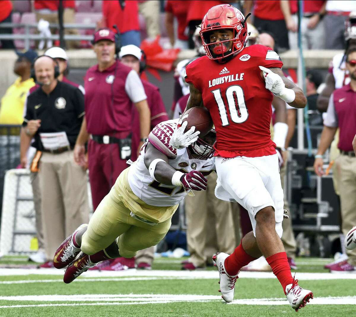 Florida State defensive back Malique Jackson tries to make a diving grab for Louisville's Jaire Alexander during the second half Saturday. Louisville won 63-20.