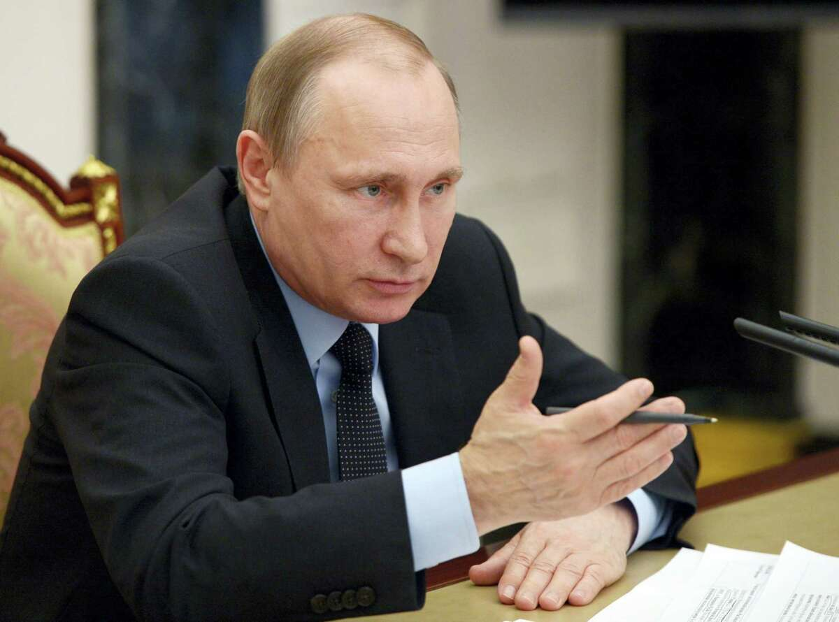 Russian President Vladimir Putin chairs a cabinet meeting in the Kremlin in Moscow, Russia, Wednesday.