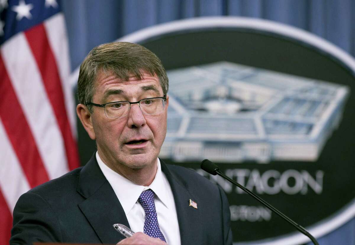 FILE - In this Dec. 11, 2015 file photo, Defense Secretary Ash Carter speaks to reporters at the Pentagon. Carter laid out broad plans Wednesday, Jan. 13, 2016, to defeat Islamic State militants and retake the group's key power centers in Iraq and Syria. And he announced that a special commando force has now arrived in Iraq.