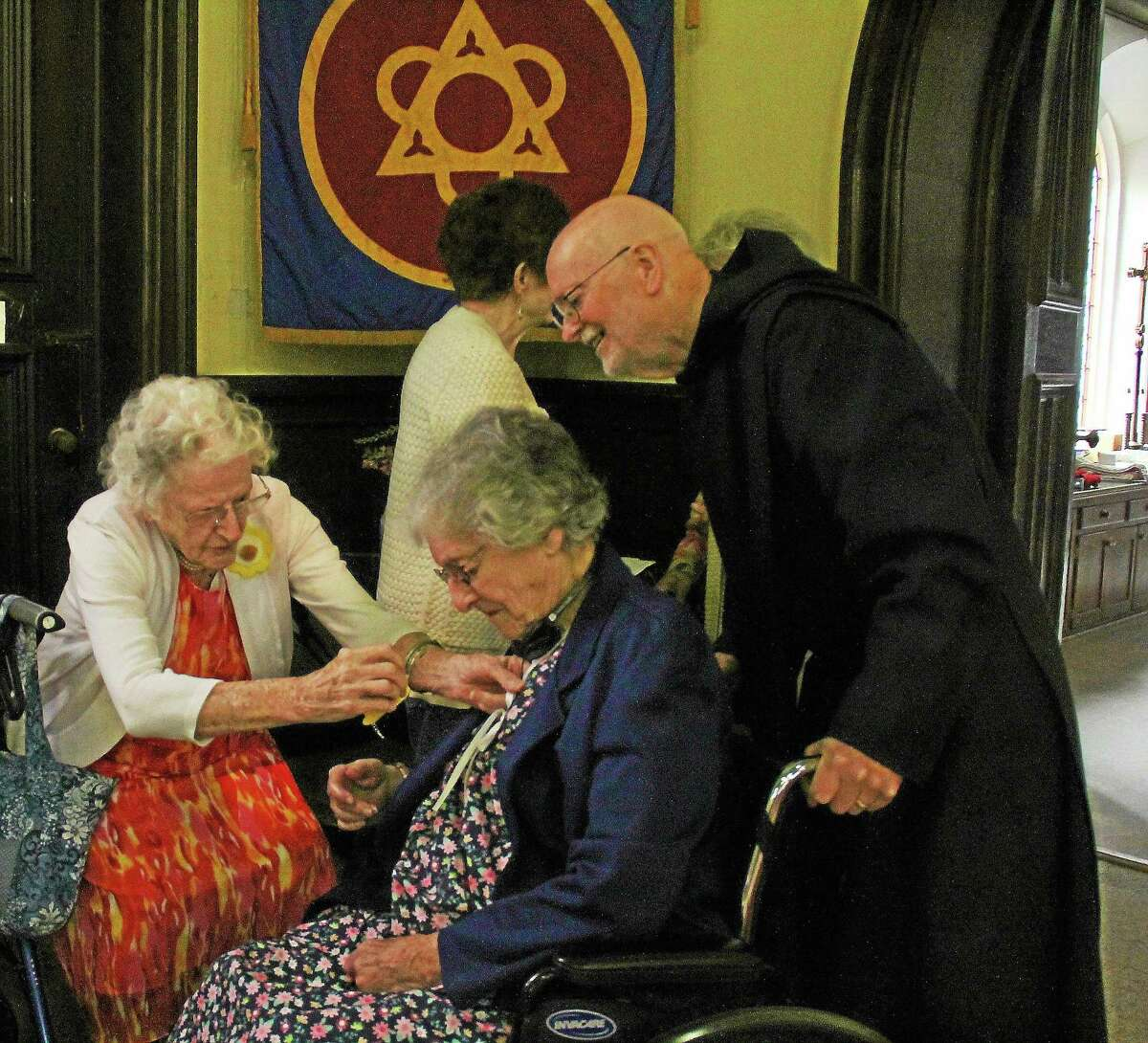 Last year's Mass for elderly shut-ins at the Church of Holy Trinity in Middletown included a hands-on blessing, lunch, music and fresh strawberry shortcake.
