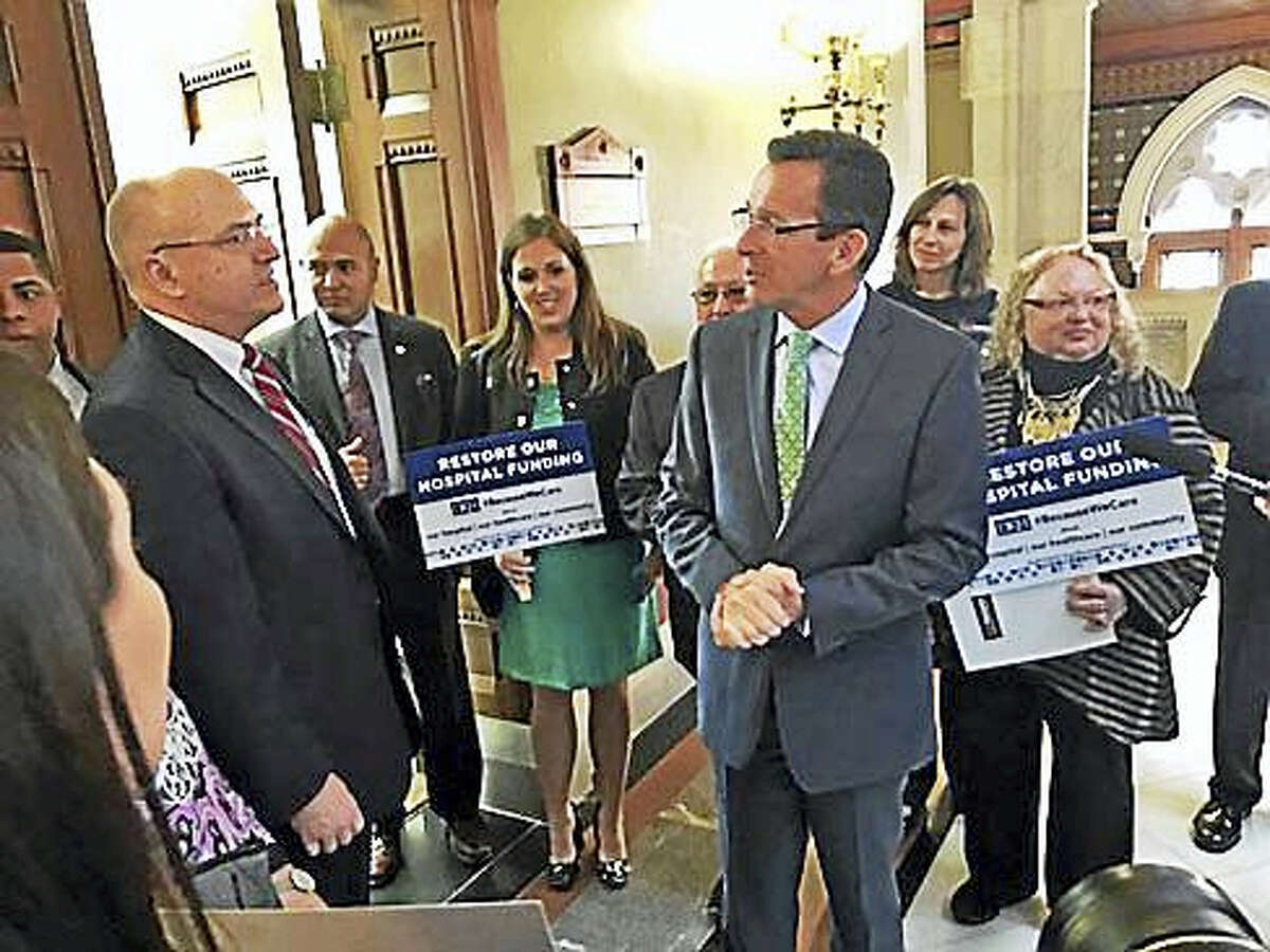 Gov. Dannel P. Malloy gets cornered by Day Kimball Hospital staff outside his Capitol office in Hartford. Sen. Mae Flexer, D-Danielson, led the group to Malloy's office Wednesday.