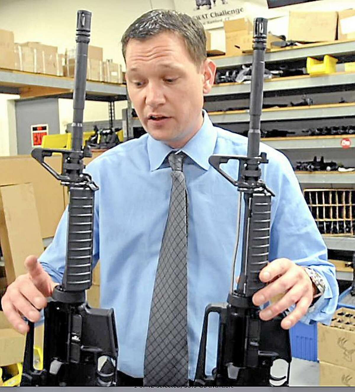 Mark Malkowski, President and CEO of Stag Arms in New Britain, displays the new Stag-22, left, a semi-automatic .22 rifle, an AR-15 looking product built from all AR-15 upper and lower components manufactured at his plant in New Britain.