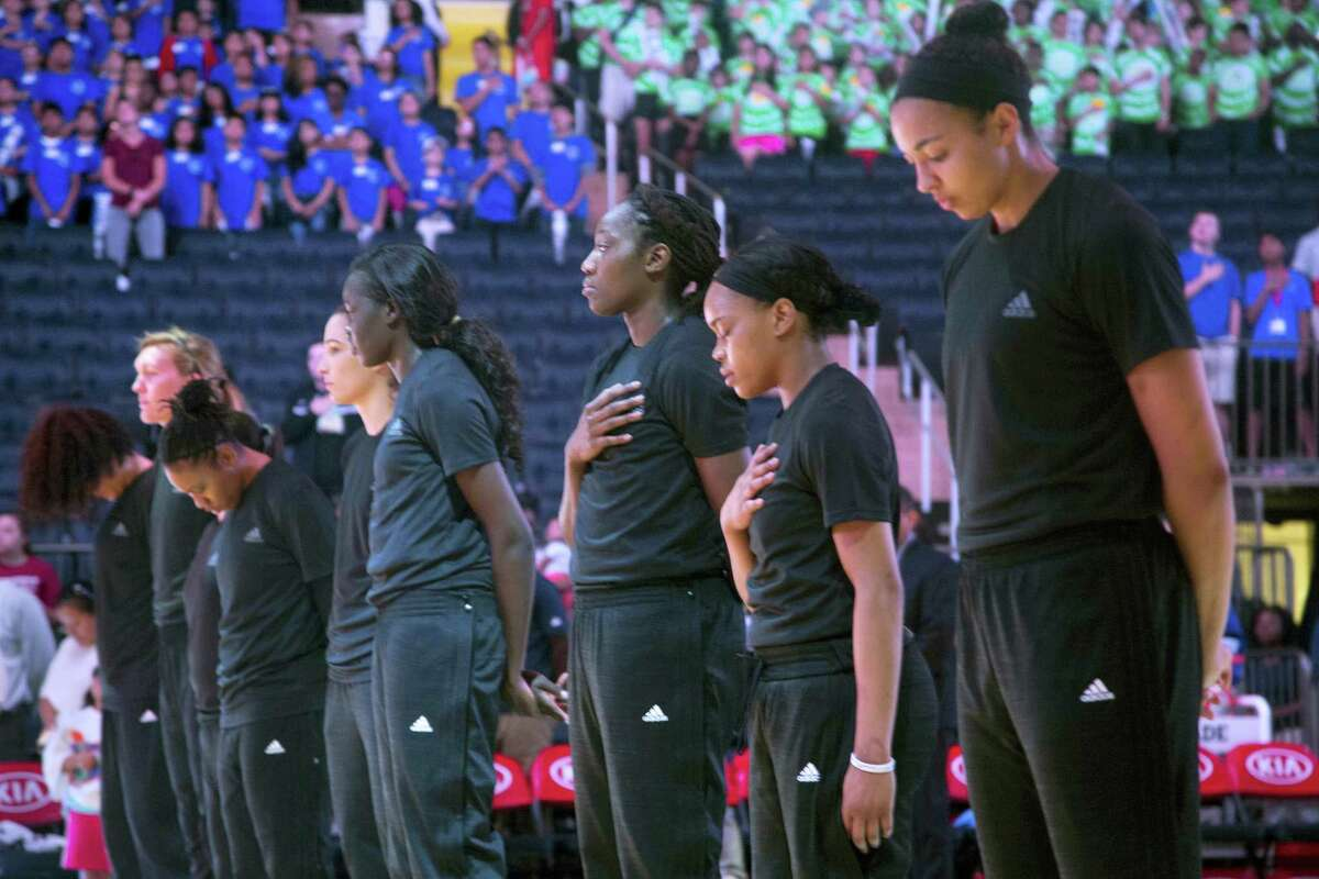 Members of the New York Liberty stand during the playing of the Star Spangled Banner prior to a recent game. Between the Black Lives Matter movement, the Orlando shooting and the LGBT community, more WNBA players have been taking active roles in expressing their views on social issues.