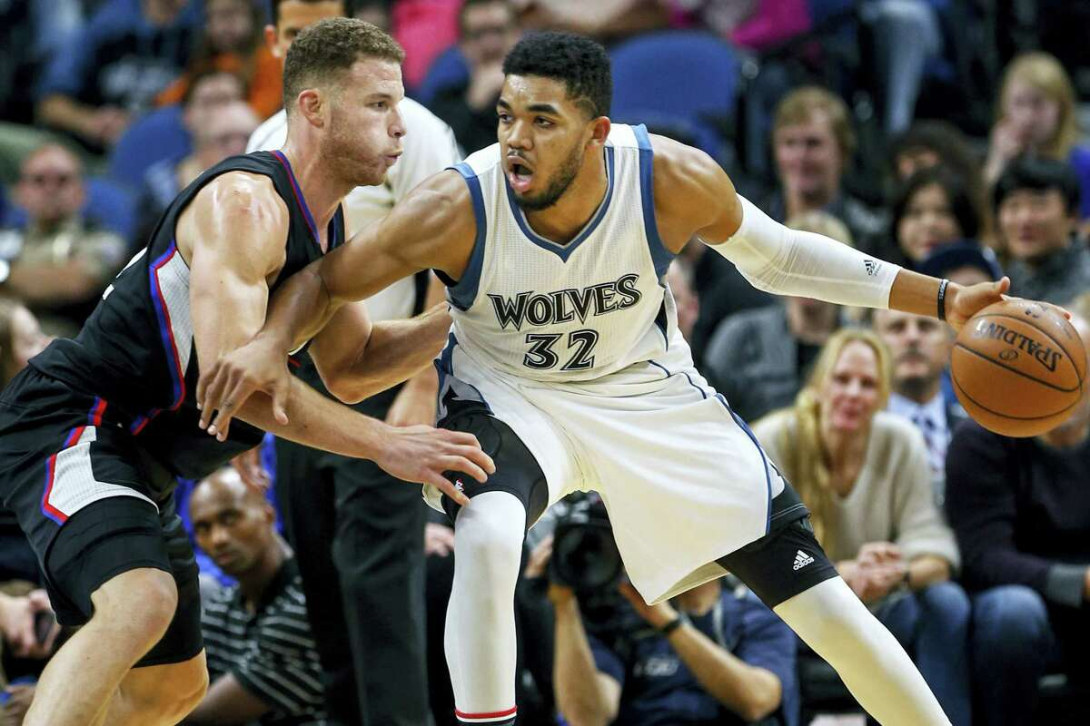 Los Angeles Clippers forward Blake Griffin (32) defends Minnesota Timberwolves center Karl-Anthony Towns (32) in the second half of an NBA basketball game on Nov. 12, 2016 in Minneapolis. The Clippers won 119-105.