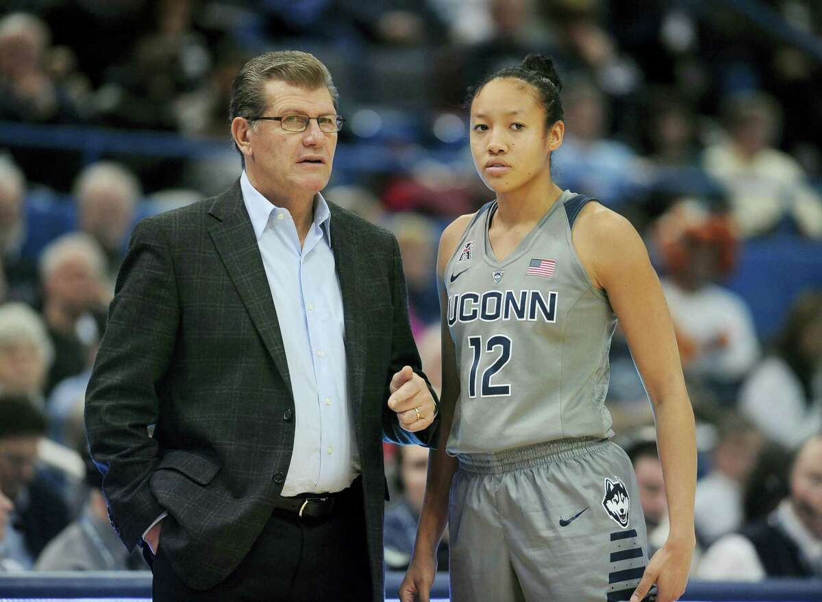 Connecticut head coach Geno Auriemma talks with Connecticut's Saniya Chong in the second half of an NCAA college basketball game, Wednesday against UCF, Jan. 20, 2016, in Hartford, Conn. UConn won 101-51. (AP Photo/Jessica Hill)
