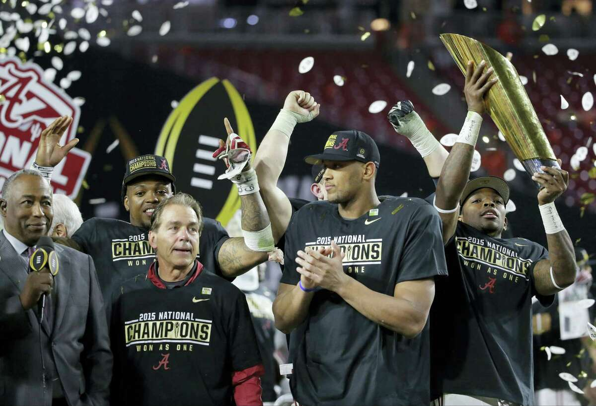 Alabama head coach Nick Saban, second from left, and players celebrate after the NCAA college football playoff championship game against Clemson Monday, Jan. 11, 2016, in Glendale, Ariz. Alabama won 45-40. (AP Photo/Chris Carlson)
