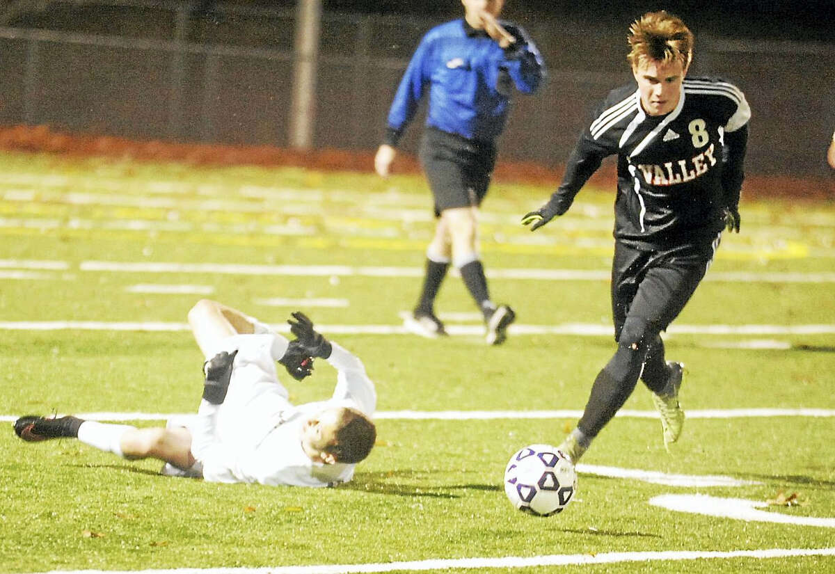 Valley Regional junior Adrian Sperzel moves the ball upfield against Coventry during Tuesday's Class S semifinal at Meriden's Falcon Field.